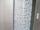 内装リフォーム扉の柄が空間のアクセント。エレベーターの内装リフォーム